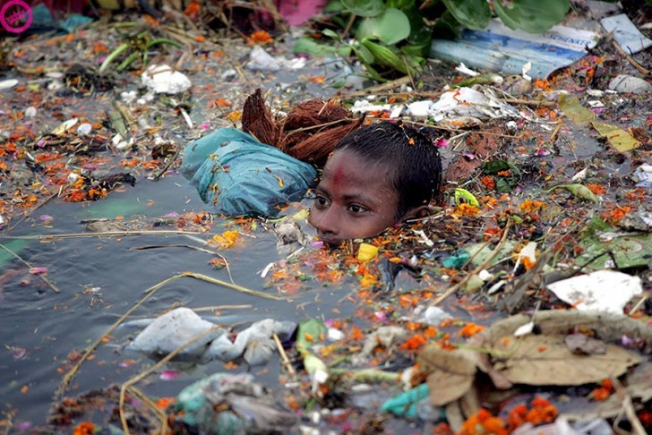 You Will Want To Recycle Everything After Seeing These Photos! - Boy Swimming In Polluted Water In India