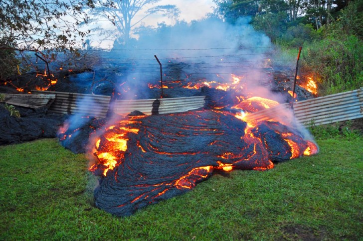 a-slow-moving-river-of-molten-lava-from-an-erupting-volcano-crept-over-residential-and-farm-property-on-hawaiis-big-island-at-the-end-of-october