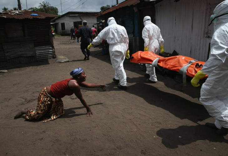 a-woman-crawled-toward-the-body-of-her-sister-as-an-ebola-burial-team-took-her-for-cremation-in-october-the-burial-of-loved-ones-is-important-in-liberian-culture-making-cremation-traumatic-f