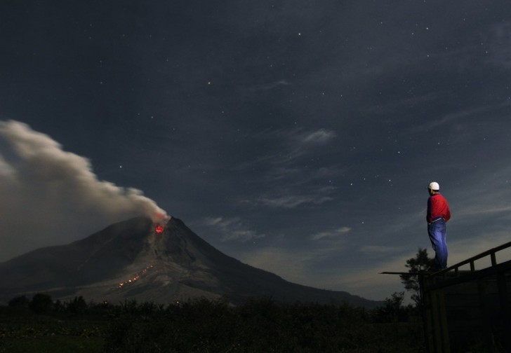 mount-sinabung-a-large-volcano-on-sumatra-island-in-indonesia-has-been-erupting-on-and-off-since-september-of-2013-covering-the-area-with-ash-and-forcing-thousands-of-people-to-flee-their-ho