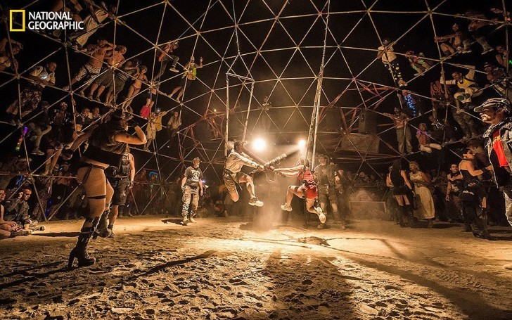 one-entry-from-national-geographics-2014-photo-contest-shows-burning-mans-thunderdome-run-by-a-group-called-the-death-guild-in-the-thunderdome-combatants-use-foam-bats-to-assault-each-other-
