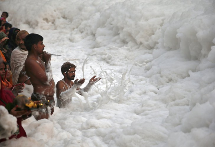 sewage-and-industrial-contaminants-create-the-foam-on-top-of-indias-yamuna-river-here-which-is-so-toxic-its-considered-dead-but-locals-still-bathe-in-the-waters-during-religious-festivals-li