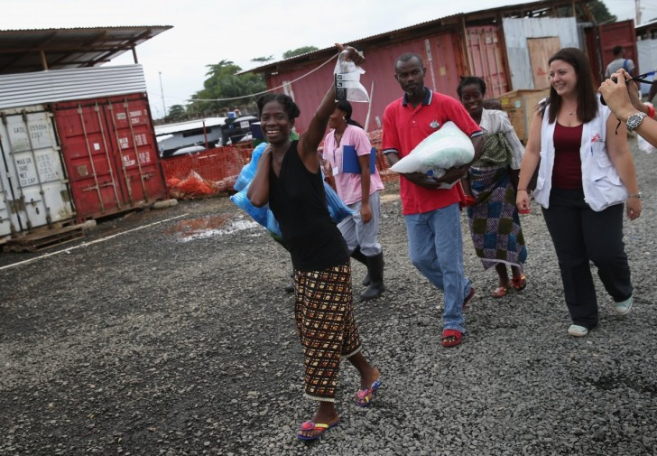 the-devastating-ebola-outbreak-this-year-was-the-largest-outbreak-of-the-frightening-virus-in-history-in-this-photo-from-october-survivor-sontay-massaley-37-leaves-an-msf-clinic-in-paynesvil