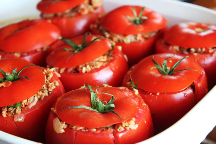 Stuffed Tomatoes in a White Baking Dish 1 of 2