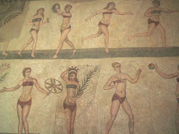 """Bikini girls"" mosaic found by archeological excavation of the ancient Roman villa near Piazza Armerina in Sicily Read more: http://www.smithsonianmag.com/arts-culture/how-bathing-suits-went-from-two-pieces-to-long-gowns-and-back-134926264/#wrfLlxYe9TGXYHH6.99 Give the gift of Smithsonian magazine for only $12! http://bit.ly/1cGUiGv Follow us: @SmithsonianMag on Twitter"