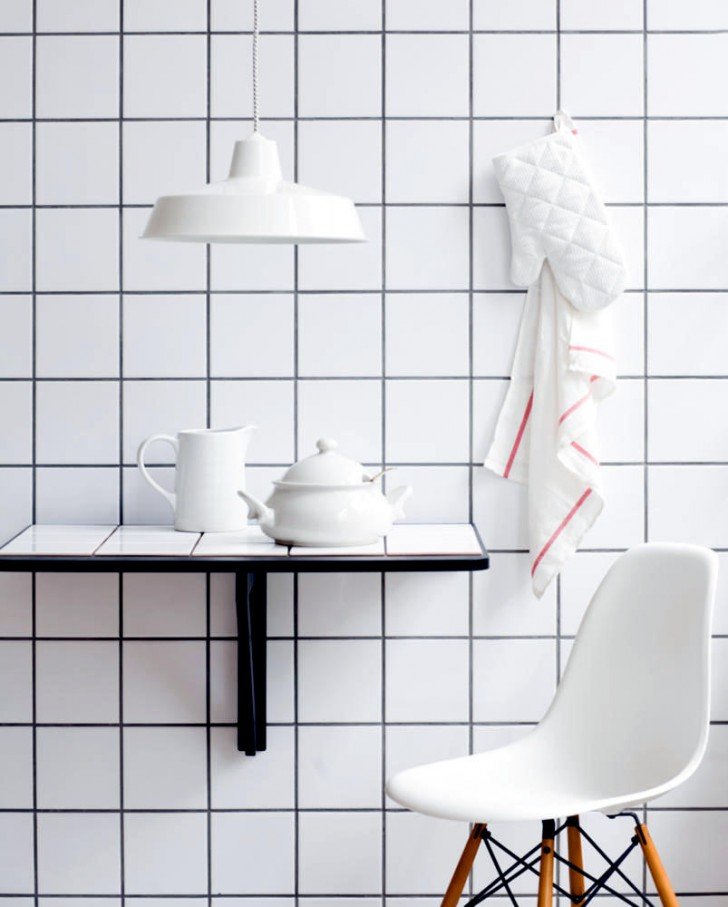 square-white-tiles-on-the-wall-and-table-0-695